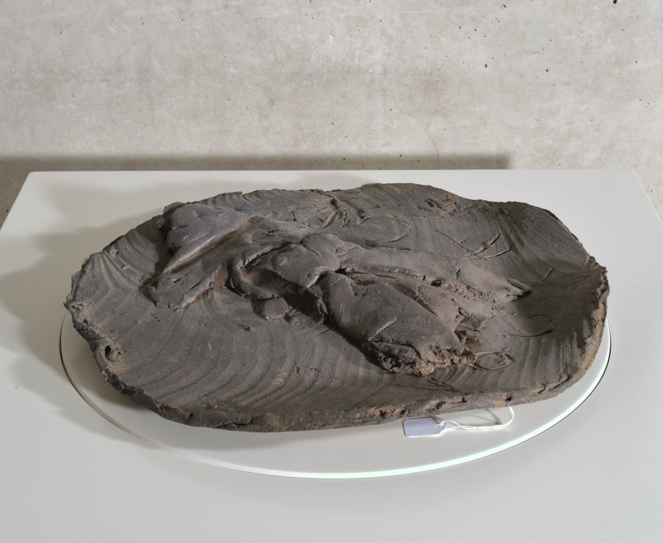 Large slab-built stoneware charger with figure